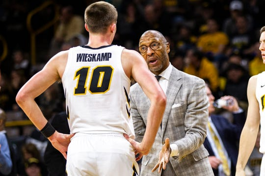 Sherman Dillard, seen here instructing Joe Wieskamp during a game last season, has been an Iowa assistant basketball coach for 11 seasons. Dillard grew up in Virginia during the civil rights era and has been following current demonstrations for racial equality with great interest.