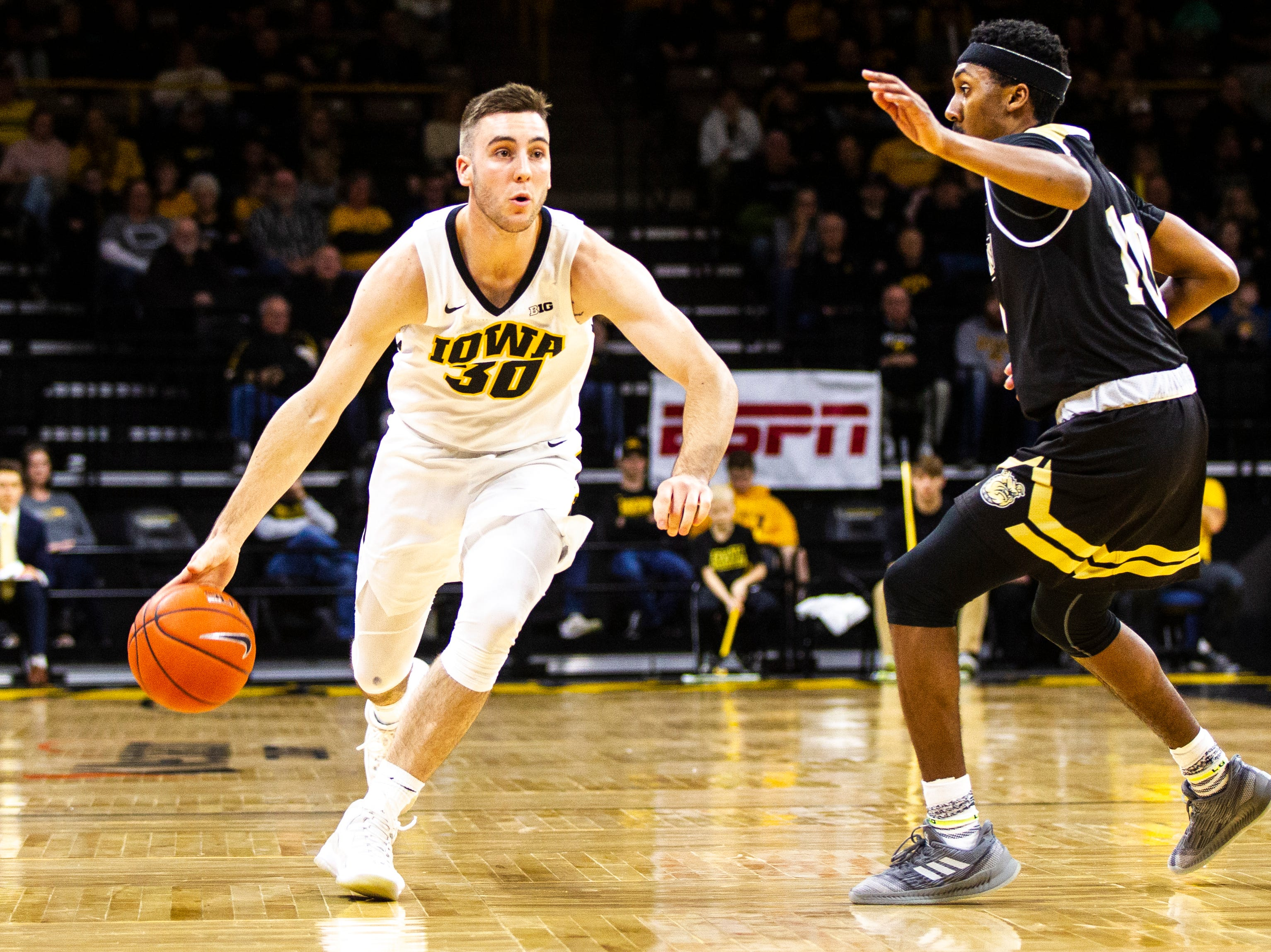 Iowa guard Connor McCaffery (30) drives to the hoop during a NCAA men's basketball game on Saturday, Dec. 29, 2018, at Carver-Hawkeye Arena in Iowa City.