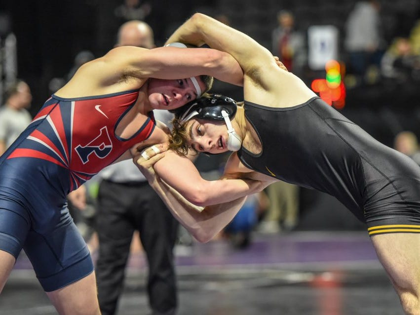Iowa's Austin DeSanto works for inside control against Penn's Doug Zapf in a match at the 2018 Midlands Championships. DeSanto won the match, 13-3, on his way to the finals at 133 pounds.