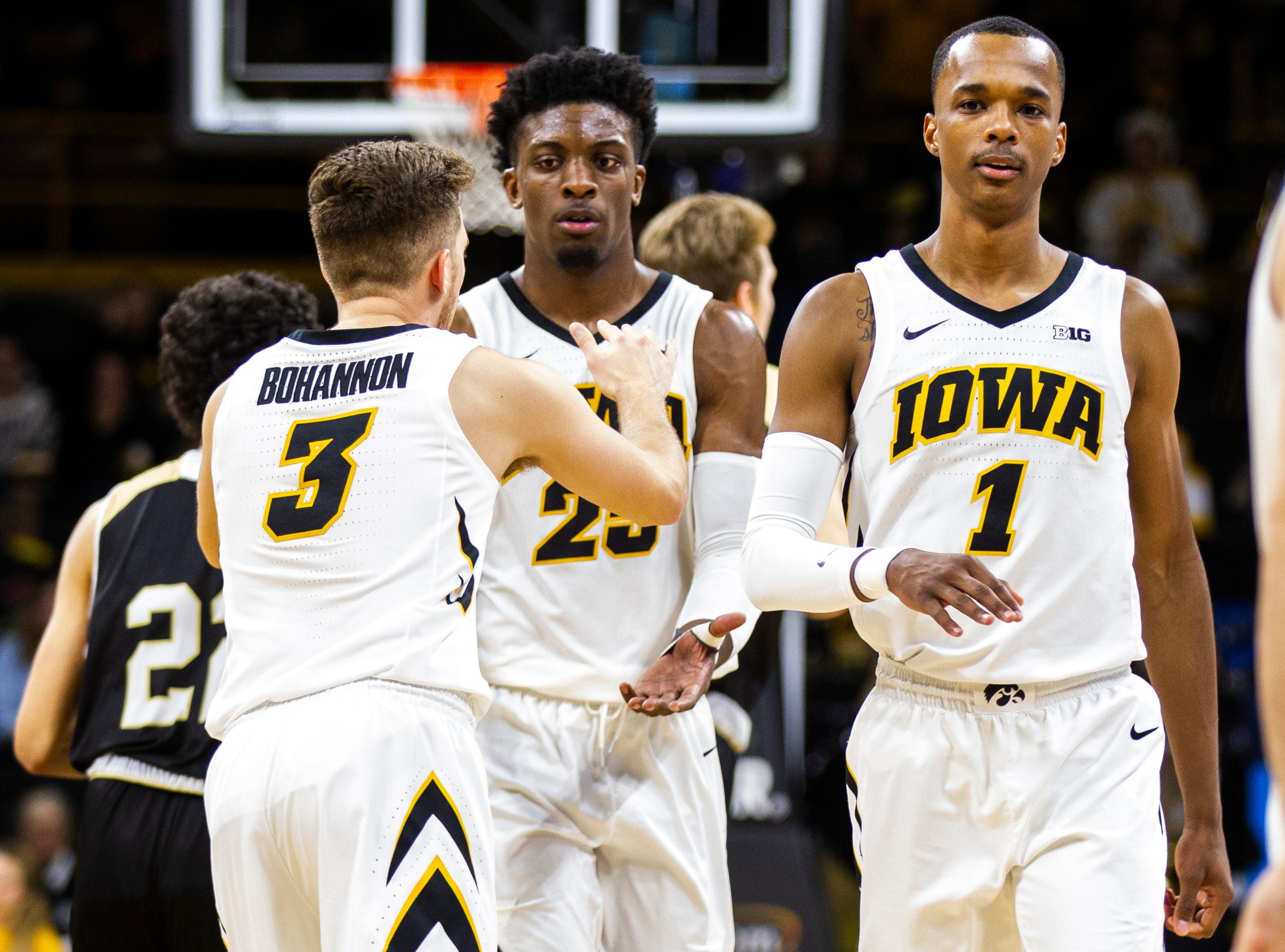 Iowa guard Jordan Bohannon (3) high-fives Iowa forward Tyler Cook (25) after a NCAA men's basketball game on Saturday, Dec. 29, 2018, at Carver-Hawkeye Arena in Iowa City. The Hawkeyes defeated the Bryant Bulldogs, 72-67.