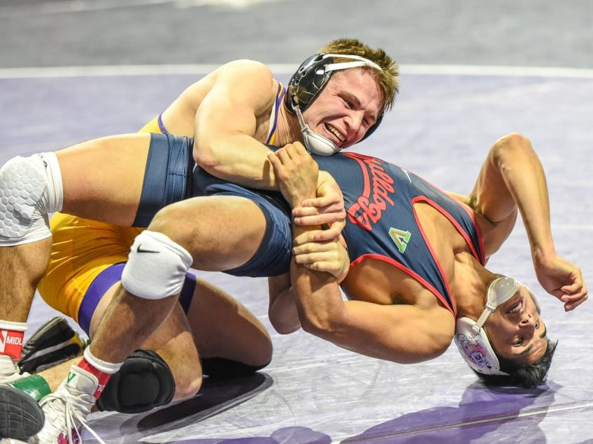 Northern Iowa's Max Thomsen turns Fresno State's Khristian Olivas during a match at the 2018 Midlands Championships. Thomsen beat Olivas 13-2 on his way to the finals at 149 pounds.