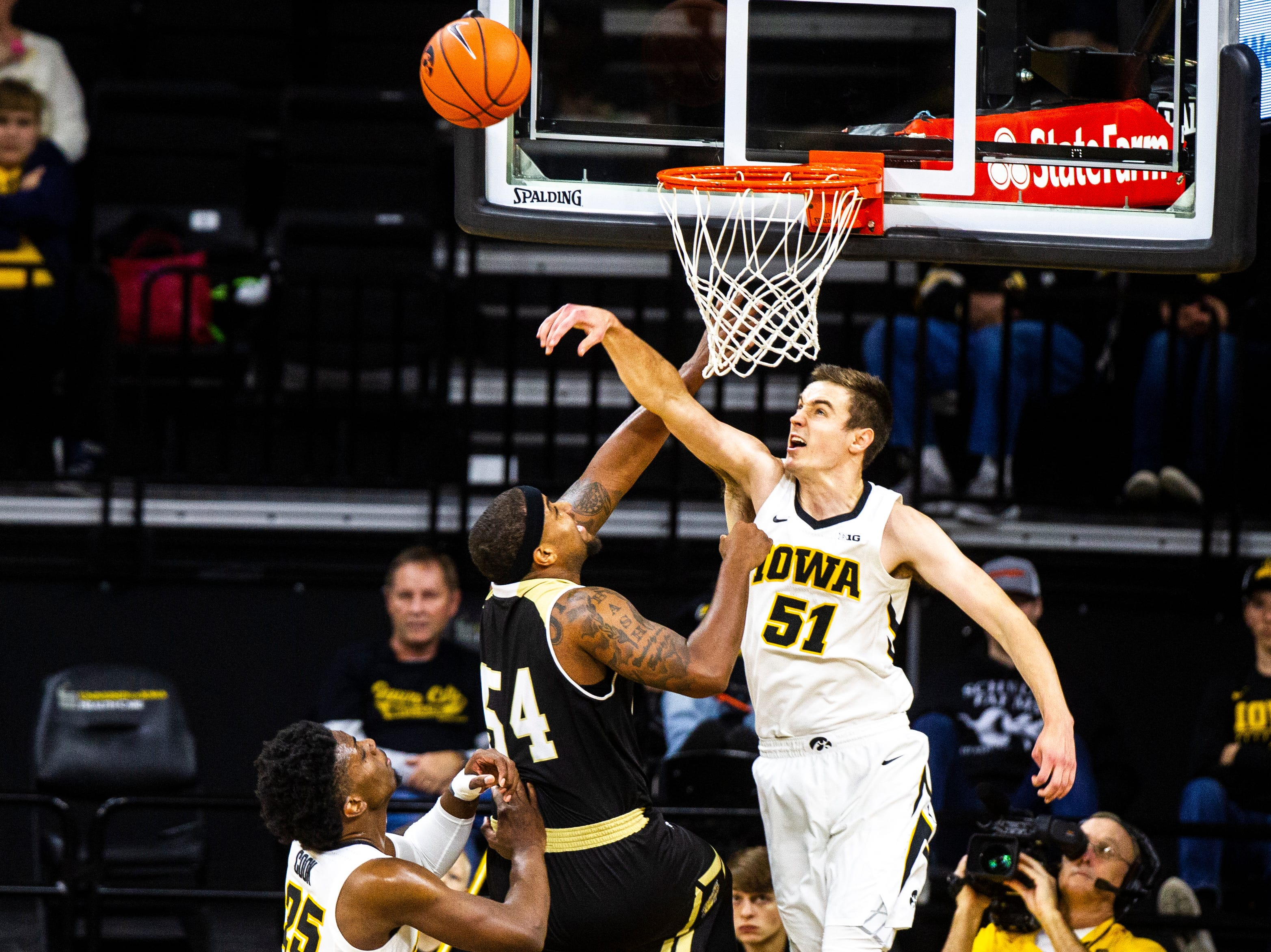 Iowa forward Nicholas Baer (51) blocks Bryant forward SaBastian Townes (54) during a NCAA men's basketball game on Saturday, Dec. 29, 2018, at Carver-Hawkeye Arena in Iowa City.