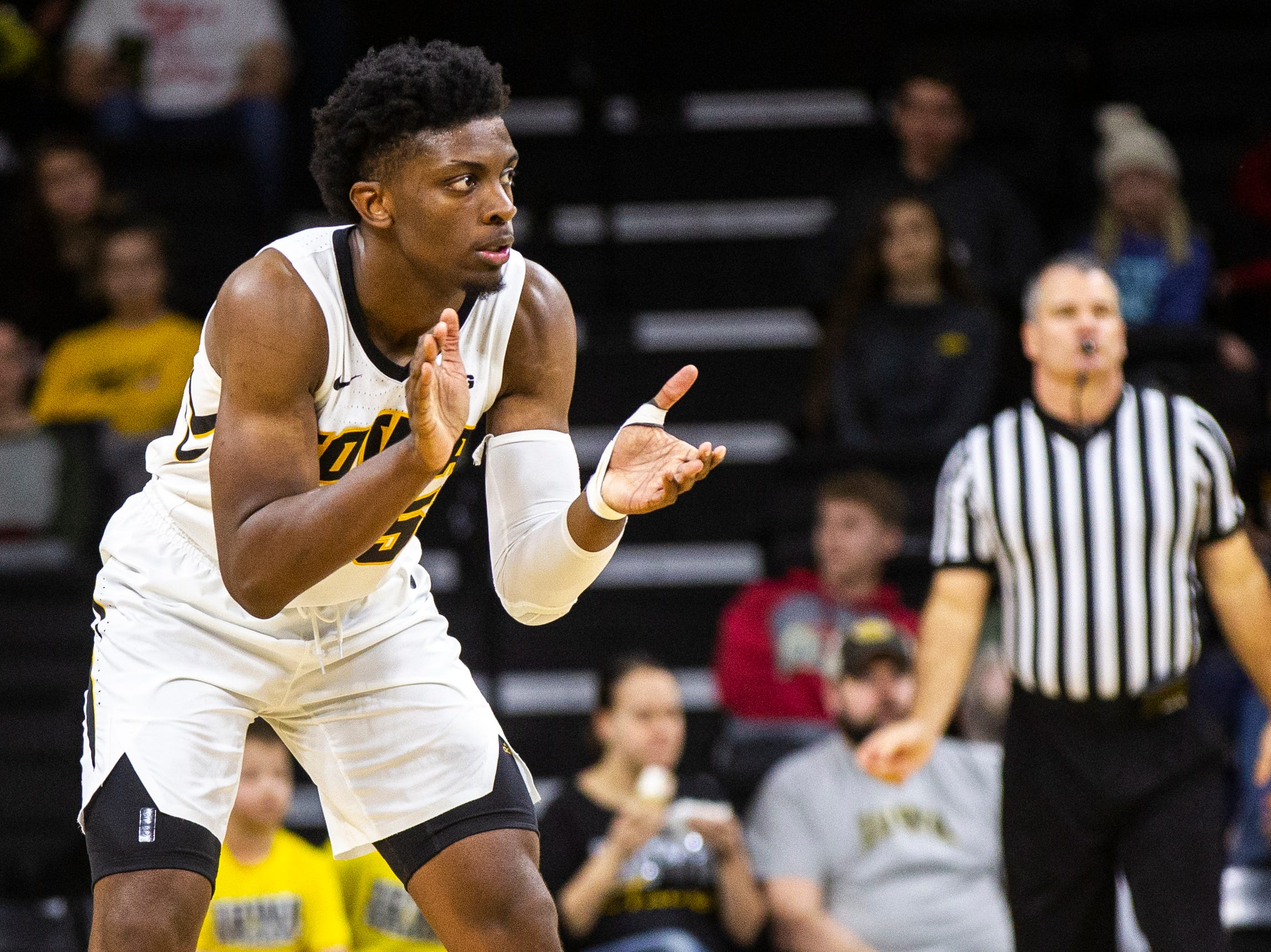 Iowa forward Tyler Cook (25) claps while back on defense during a NCAA men's basketball game on Saturday, Dec. 29, 2018, at Carver-Hawkeye Arena in Iowa City.