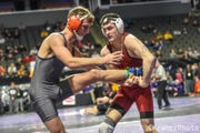 Northern Iowa's Michael Blockhus tries to finish a shot against Bucknell's Joey Gould in a match at the 2018 Midlands Championships. Blockhus won, 8-3, to advance to the semifinals at 141 pounds.