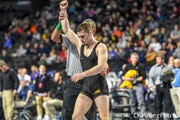 Iowa's Spencer Lee gets his hand raised after winning a match at the 2018 Midlands Championships. Lee reached the finals at 125 pounds.
