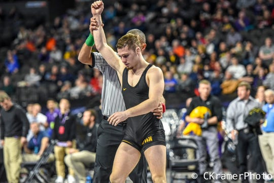 Spencer Lee, pictured here after winning a match at the 2018 Midlands Championships, defeated Minnesota's Sean Russell, 4-0, on Sunday in Iowa's 24-10 win over the Gophers.