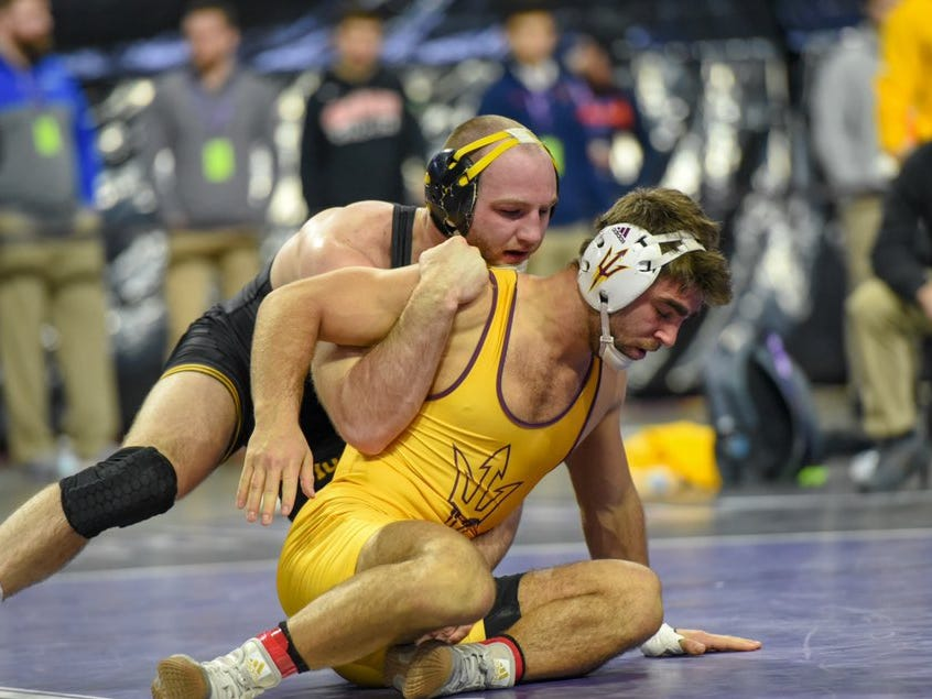 Iowa's Alex Marinelli wrestles Arizona State's Joshua Shields in the semifinals of the 2018 Midlands Championships. Marinelli beat Shields, 4-1, to advance to the finals at 165 pounds.