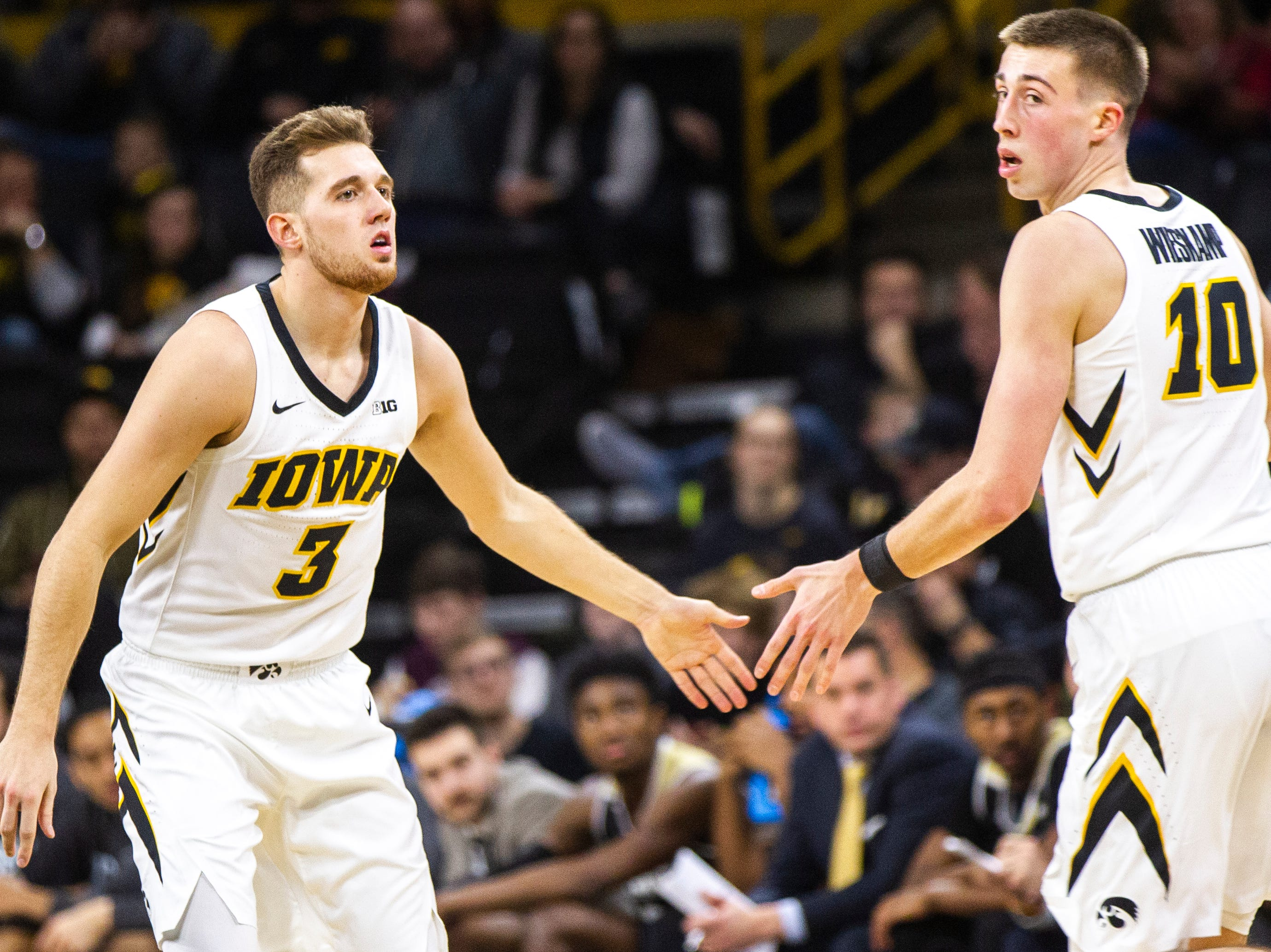 Iowa guard Jordan Bohannon (3) high-fives Iowa guard Joe Wieskamp (10) during a NCAA men's basketball game on Saturday, Dec. 29, 2018, at Carver-Hawkeye Arena in Iowa City.
