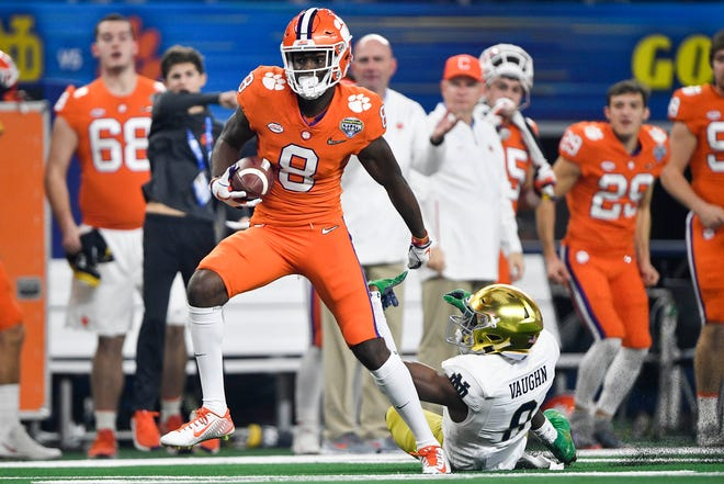 Clemson Tigers wide receiver Justyn Ross (8) escapes the defense of Notre Dame Fighting Irish cornerback Donte Vaughn (8) for a touchdown during the second quarter in the 2018 Cotton Bowl college football playoff semifinal game at AT&T Stadium.