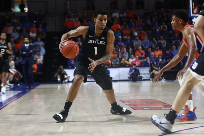 Jordan Tucker (1) scored eight points off the bench for Butler in Saturday's blowout loss at Florida.