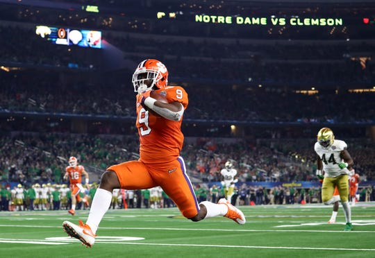 Dec 29, 2018; Arlington, TX, United States; Clemson Tigers running back Travis Etienne (9) scores a touchdown against the Notre Dame Fighting Irish in the second half in the 2018 Cotton Bowl college football playoff semifinal game at AT&T Stadium. Mandatory Credit: Matthew Emmons-USA TODAY Sports