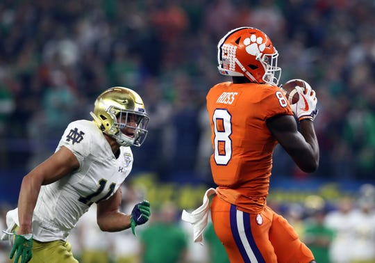 Clemson Tigers wide receiver Justyn Ross (8) catches a touchdown pass against Notre Dame Fighting Irish safety Alohi Gilman (11) in the first half in the 2018 Cotton Bowl college football playoff semifinal game at AT&T Stadium.