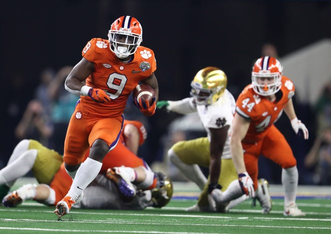 Clemson Tigers running back Travis Etienne (9) scores a touchdown against the Notre Dame Fighting Irish in the second half in the 2018 Cotton Bowl college football playoff semifinal game at AT&T Stadium.