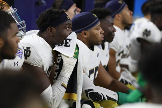 Notre Dame Fighting Irish react at the end of the game in the 2018 Cotton Bowl college football playoff semifinal game against the Clemson Tigers at AT&T Stadium.