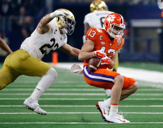 Notre Dame linebacker Drue Tranquill (23) prepared to wrap up Clemson wide receiver Hunter Renfrow after a catch in the the NCAA Cotton Bowl semi-final playoff football game Dec. 29 in Arlington, Texas. (AP Photo/Michael Ainsworth)