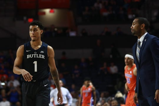 Butler's Jordan Tucker (1) scored eight points off the bench in Saturday's blowout loss in Gainesville.