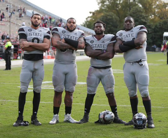 Mississippi State defensive linemen Montez Sweat (far left),  Jeffery Simmons  (middle left), Chauncey Rivers (middle right) and Cory Thomas (far right) were members of a record-setting Bulldog defensive line during the 2018 season.