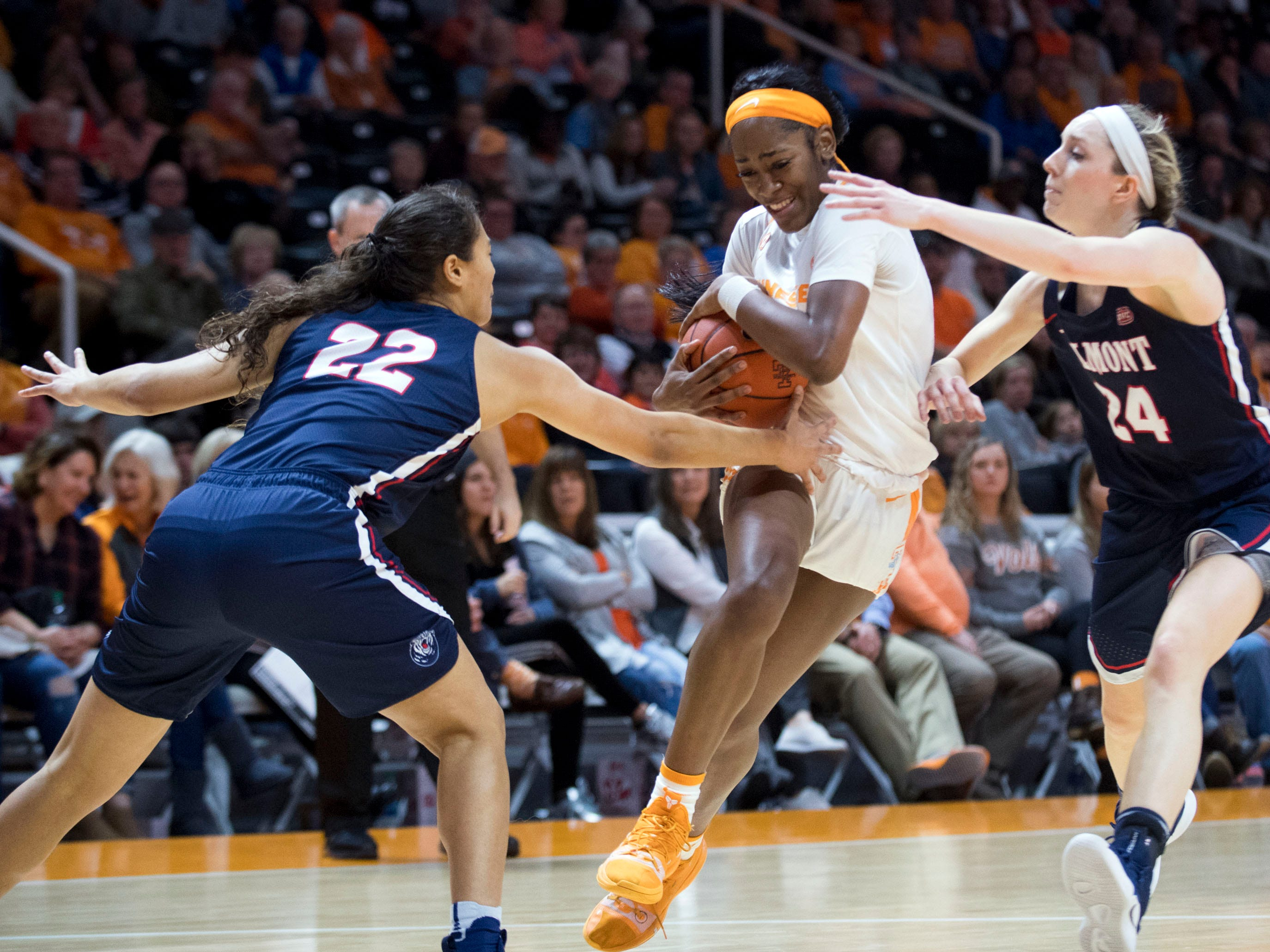 Tennessee's Zaay Green (14) tries to get through Belmont's Maddie Cook (22) and Jenny Roy (24) on Sunday, December 30, 2018.