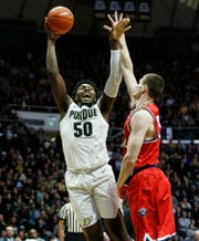 Trevion Williams of Purdue with a shot over Seth Adelsperger of Belmont Saturday, December 29, 2018, at Mackey Arena. Purdue defeated Belmont 73-62.