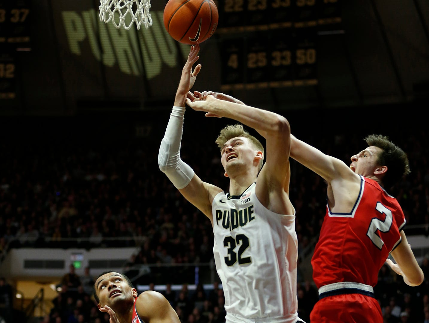 Matt Haarms of Purdue is fouled by Grayson Murphy of Belmont Saturday, December 29, 2018, at Mackey Arena. Purdue defeated Belmont 73-62.