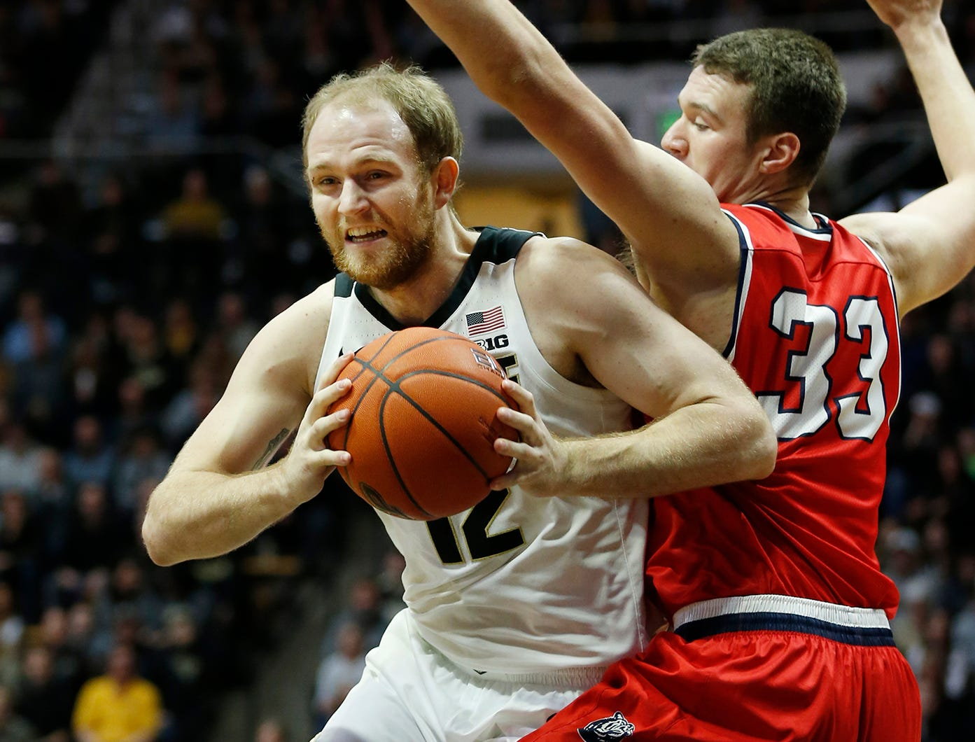 Evan Boudreaux of Purdue works for a shot against Nick Muszynski of Belmont Saturday, December 29, 2018, at Mackey Arena. Purdue defeated Belmont 73-62.