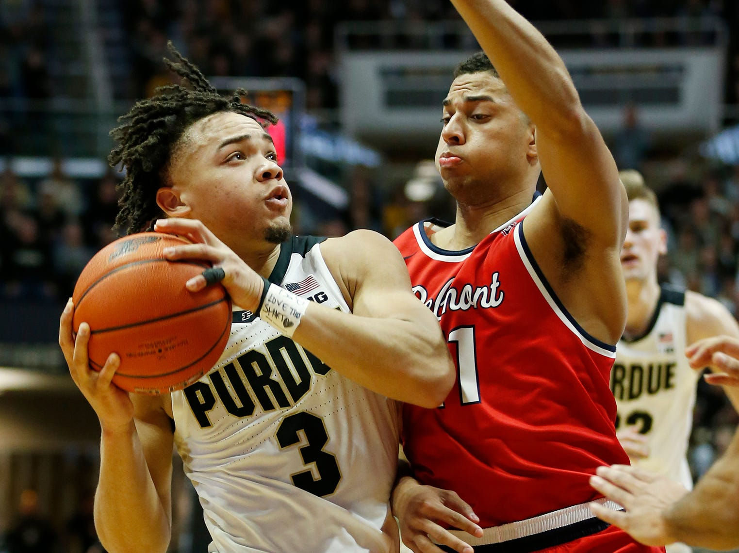 Carsen Edwards of Purdue with a drive against Kevin McClain of Belmont Saturday, December 29, 2018, at Mackey Arena. Purdue defeated Belmont 73-62.