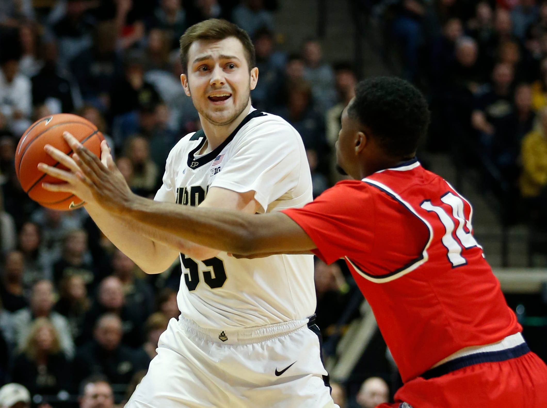 Sasha Stefanovic of Purdue looks to work the ball into the post past Nick Hopkins of Belmont Saturday, December 29, 2018, at Mackey Arena. Purdue defeated Belmont 73-62.