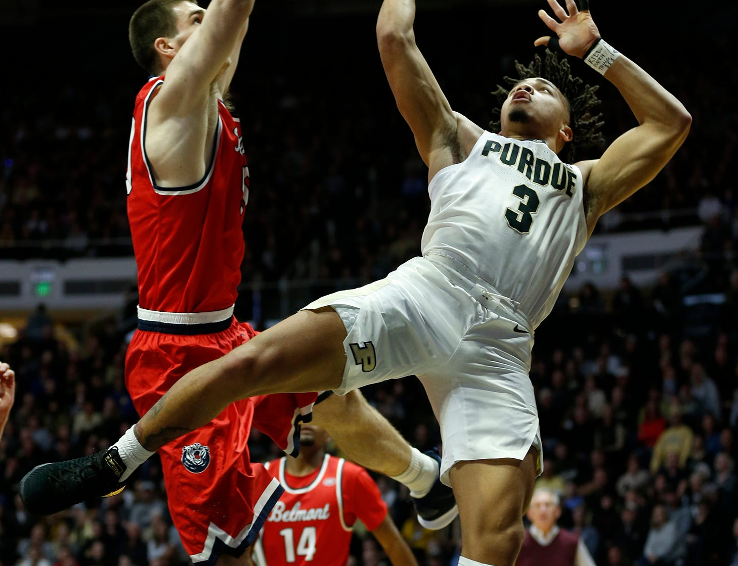 Carsen Edwards of Purdue with a shot against Seth Adelsperger of Belmont Saturday, December 29, 2018, at Mackey Arena. Purdue defeated Belmont 73-62.