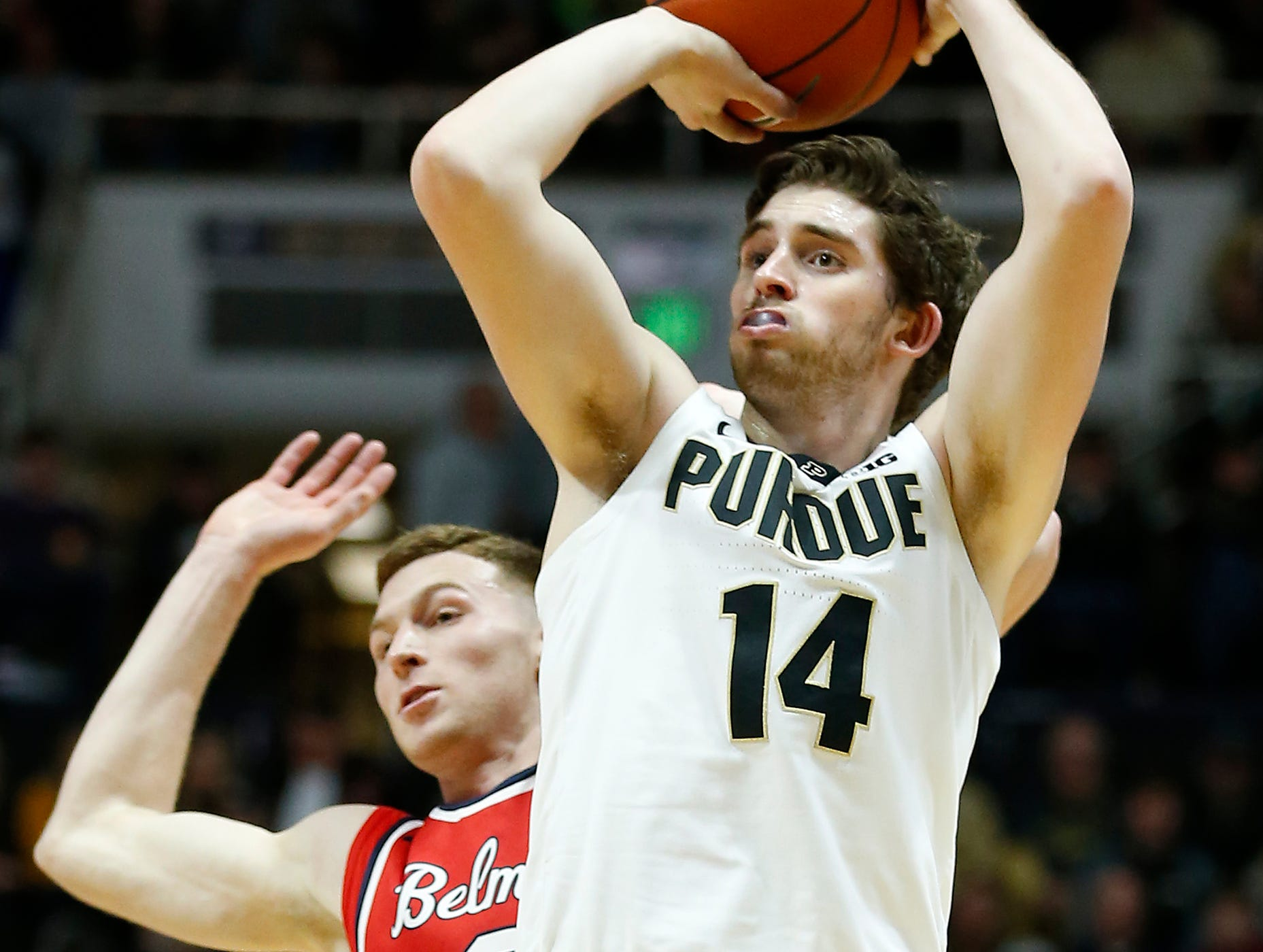 Ryan Cline of Purdue gets around Dylan Windler of Belmont for a three-point shot Saturday, December 29, 2018, at Mackey Arena. Purdue defeated Belmont 73-62.