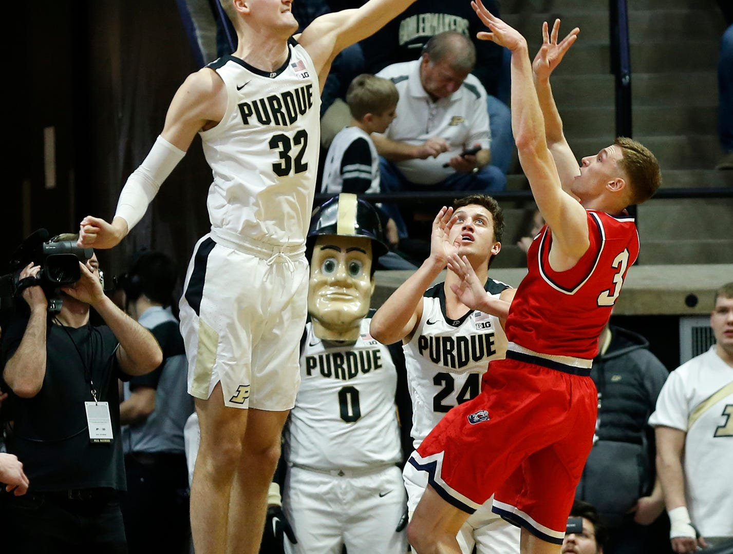 Matt Haarms of Purdue blocks a shot by Dylan Windler of Belmont Saturday, December 29, 2018, at Mackey Arena. Purdue defeated Belmont 73-62.