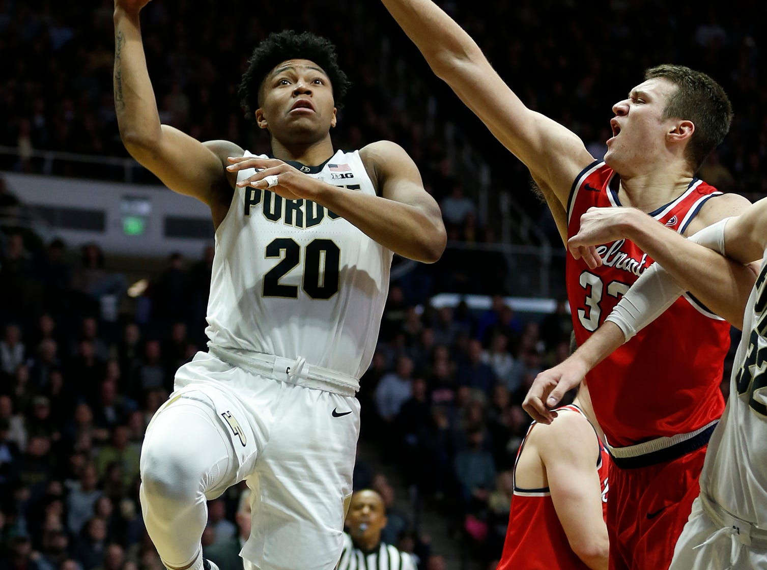 Nojel Eastern of Purdue with a drive to the basket for a shot against Nick Muszynski of Belmont Saturday, December 29, 2018, at Mackey Arena. Purdue defeated Belmont 73-62.
