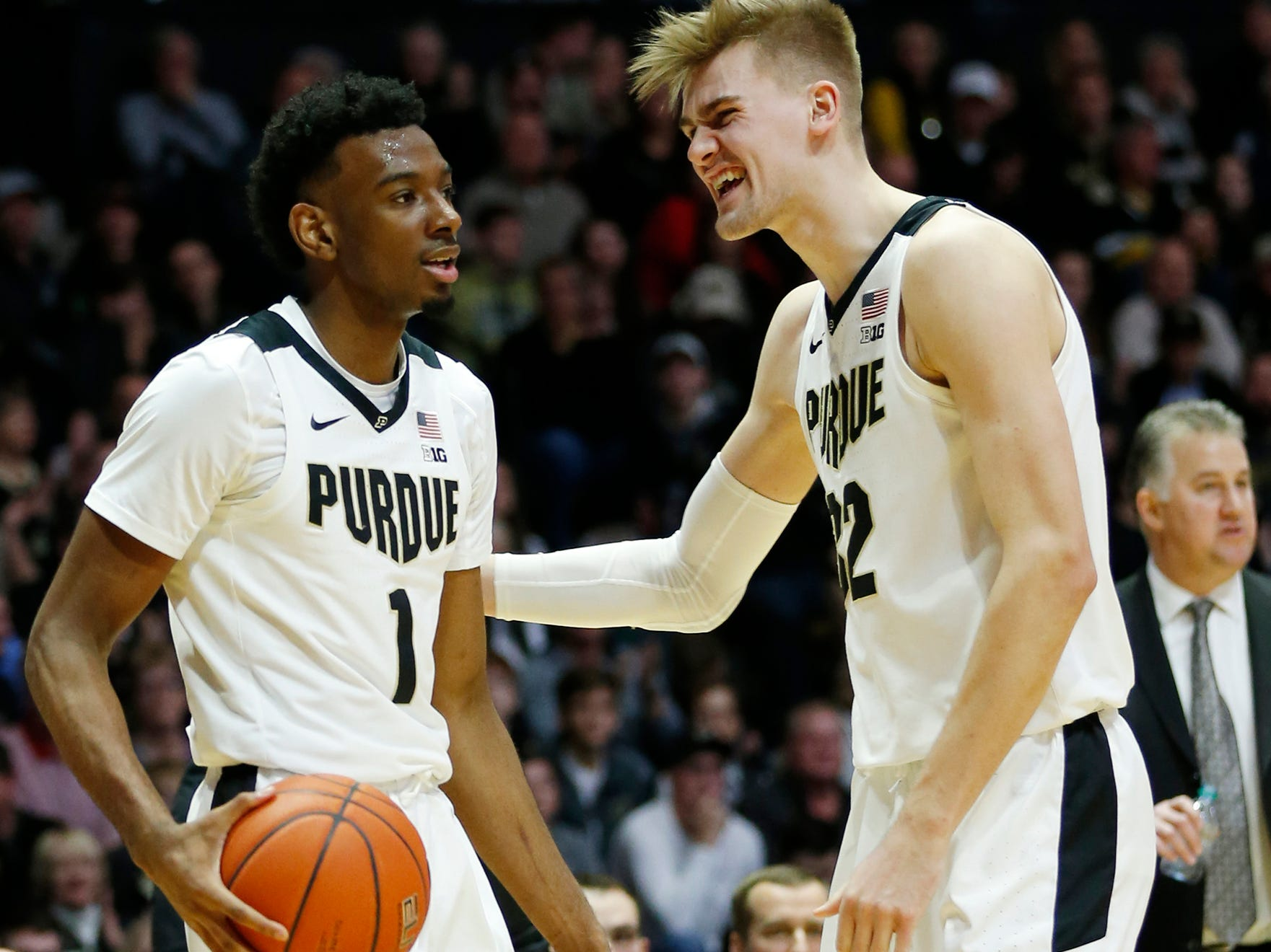 Matt Haarms of Purdue congratulates teammate Aaron Wheeler after Wheeler hauled in an offensive rebound and drew a Belmont foul Saturday, December 29, 2018, at Mackey Arena. Purdue defeated Belmont 73-62.