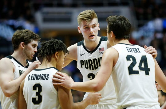 Matt Haarms of Purdue huddles with his teammates before Nojel Eastern shoots a free throw against Belmont Saturday, December 29, 2018, at Mackey Arena. Purdue defeated Belmont 73-62.