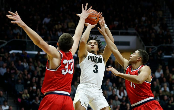 Carsen Edwards of Purdue with a shot over Nick Muszynski, left, and Kevin McClain of Belmont Saturday, December 29, 2018, at Mackey Arena. Purdue defeated Belmont 73-62.