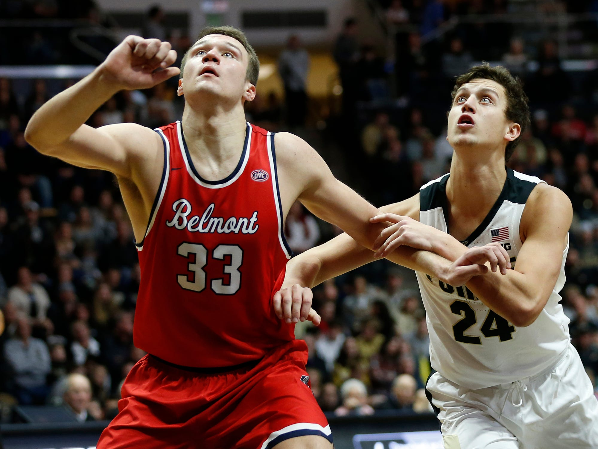 Grady Eifert of Purdue and Nick Muszynski of Belmont jockey for position as the Boilermakers shoot a free throw in the second half Saturday, December 29, 2018, at Mackey Arena. Purdue defeated Belmont 73-62.