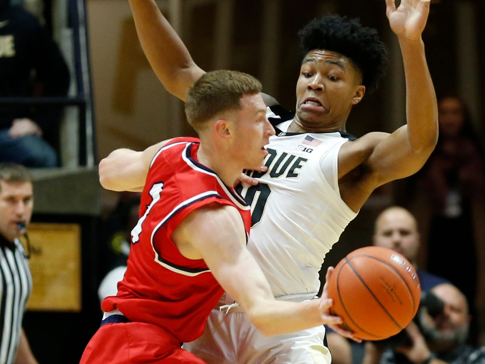 Nojel Eastern of Purdue tries to stop a drive by Dylan Windler of Belmont Saturday, December 29, 2018, at Mackey Arena. Purdue defeated Belmont 73-62.