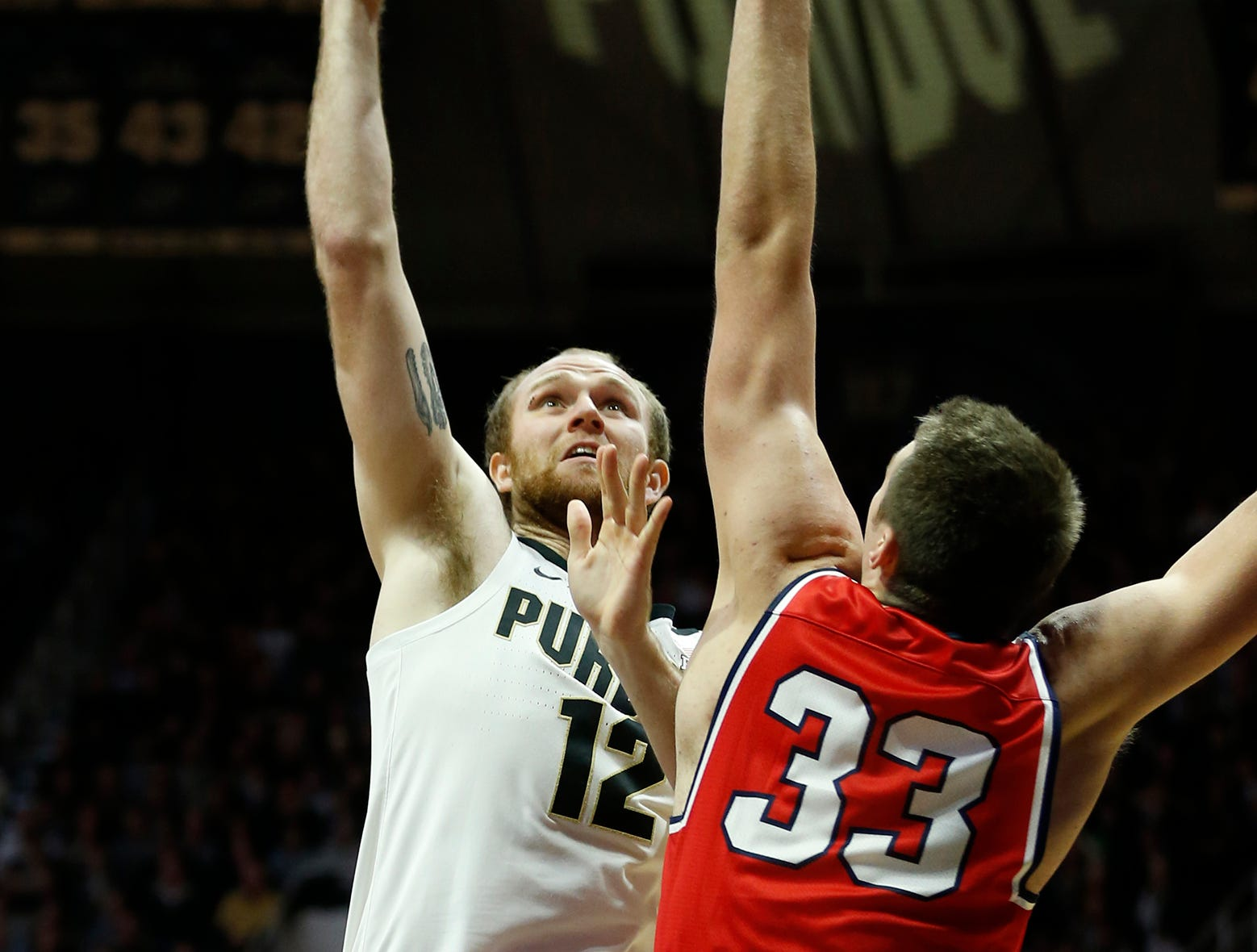 Evan Boudreaux of Purdue with a shot over Nick Muszynski of Belmont Saturday, December 29, 2018, at Mackey Arena. Purdue defeated Belmont 73-62.