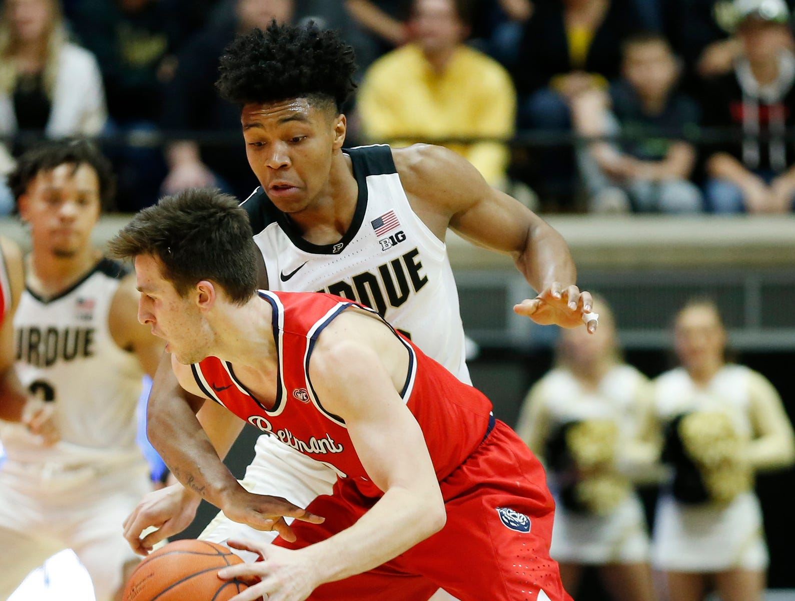 Nojel Eastern of Purdue reaches to try and steal the ball from Grayson Murphy of Belmont Saturday, December 29, 2018, at Mackey Arena. Purdue defeated Belmont 73-62.