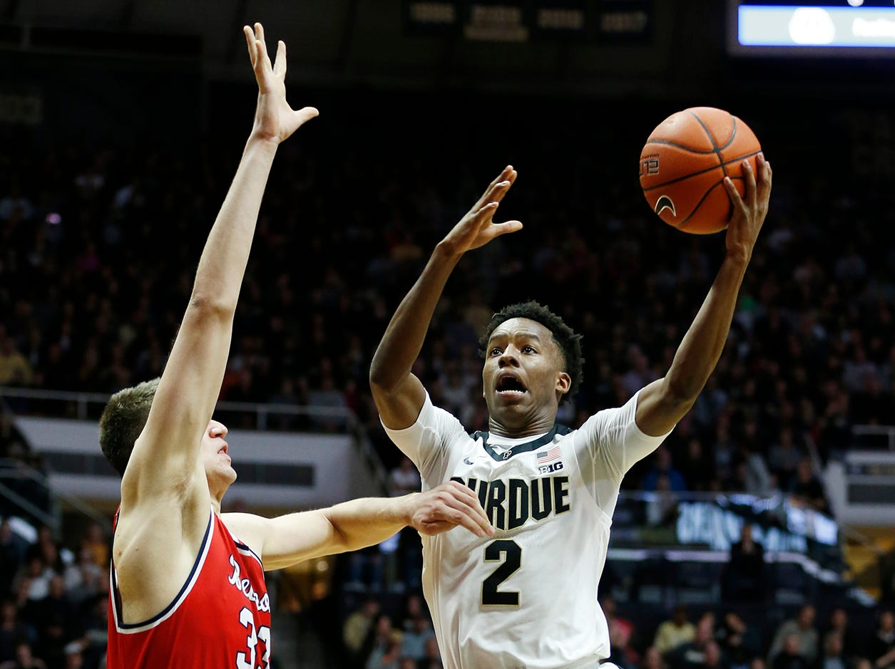 Eric Hunter of Purdue with a drive into the lane for a shot over Nick Muszynski of Belmont Saturday, December 29, 2018, at Mackey Arena. Purdue defeated Belmont 73-62.