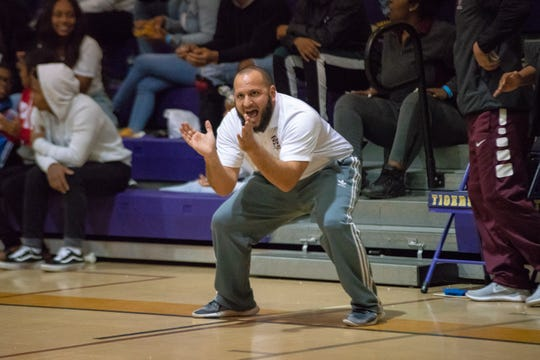 Breaux Bridge coach Chad Pourciau celebrates a call on the sideline during a recent game against Hamilton Christian.