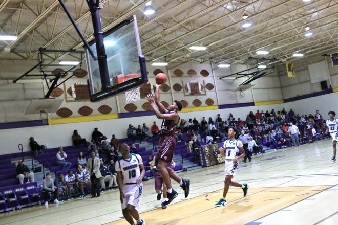 Breaux Bridge's Trevonte Sylvester goes for the basket as the Breaux Bridge Tigers take on the Hamilton Christian Warriors in the finals of the St. Martinville Holiday Tournament  Saturday, Dec. 29, 2018.