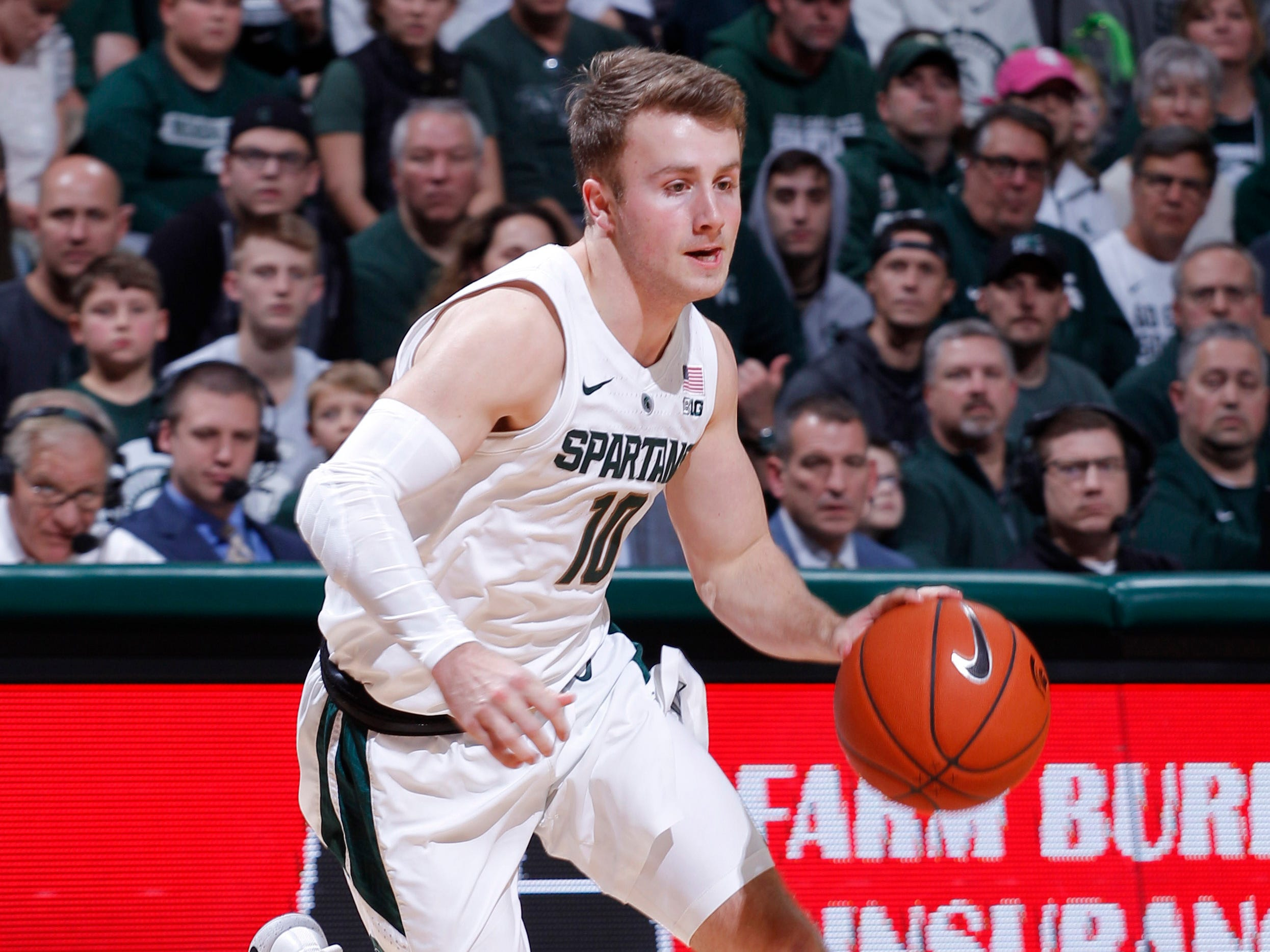 Michigan State's Jack Hoiberg drives against Northern Illinois, Saturday, Dec. 29, 2018, in East Lansing, Mich.
