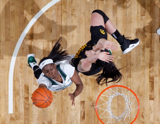 Michigan State's Mardrekia Cook, left, shoots against Iowa's Megan Gustafson during an NCAA college basketball game, Sunday, Dec. 30, 2018, in East Lansing, Mich. Michigan State won 84-70. (AP Photo/Al Goldis)