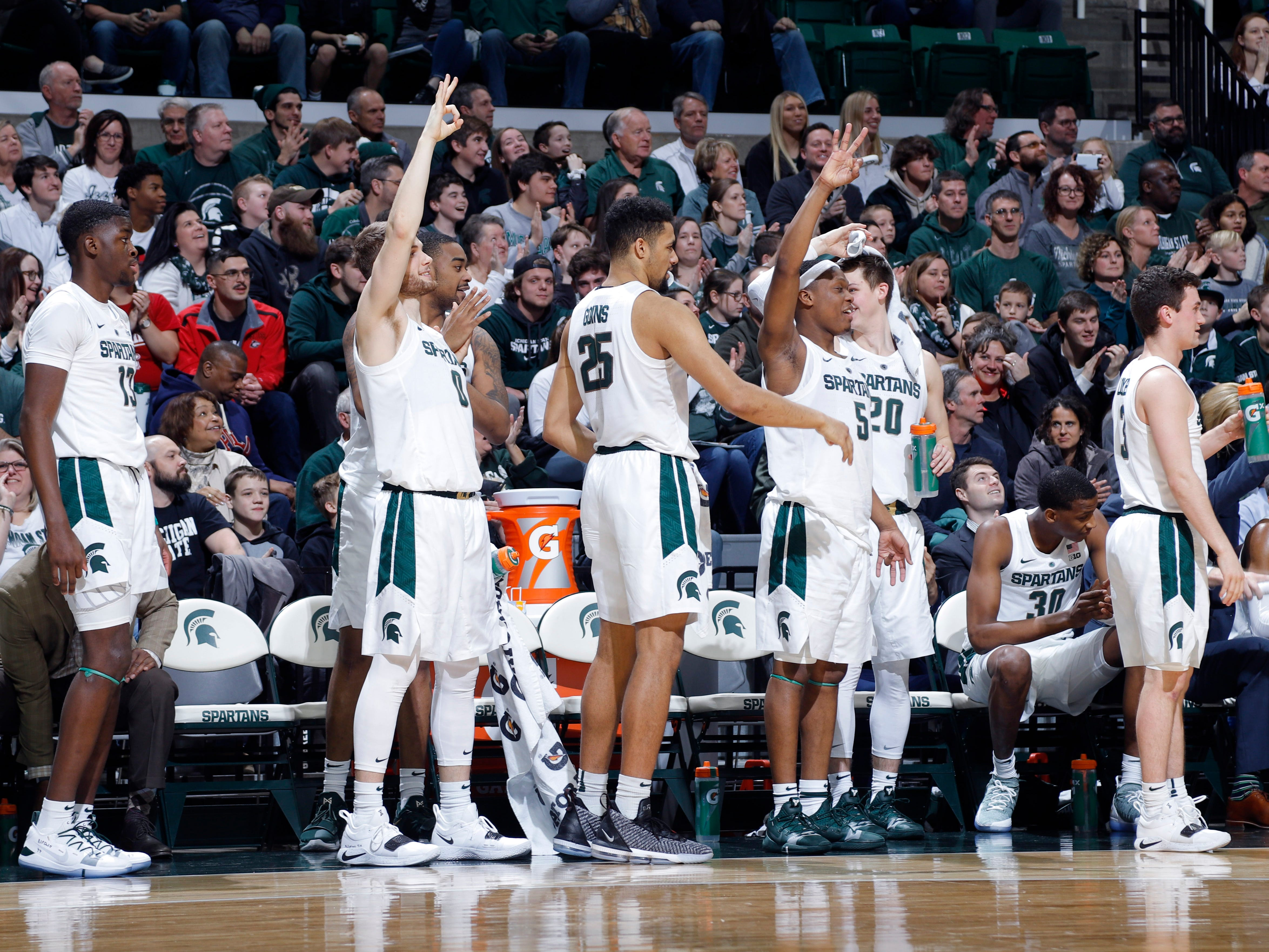 Michigan State's bench celebrates in the closing minutes against Northern Illinois, Saturday, Dec. 29, 2018, in East Lansing, Mich.