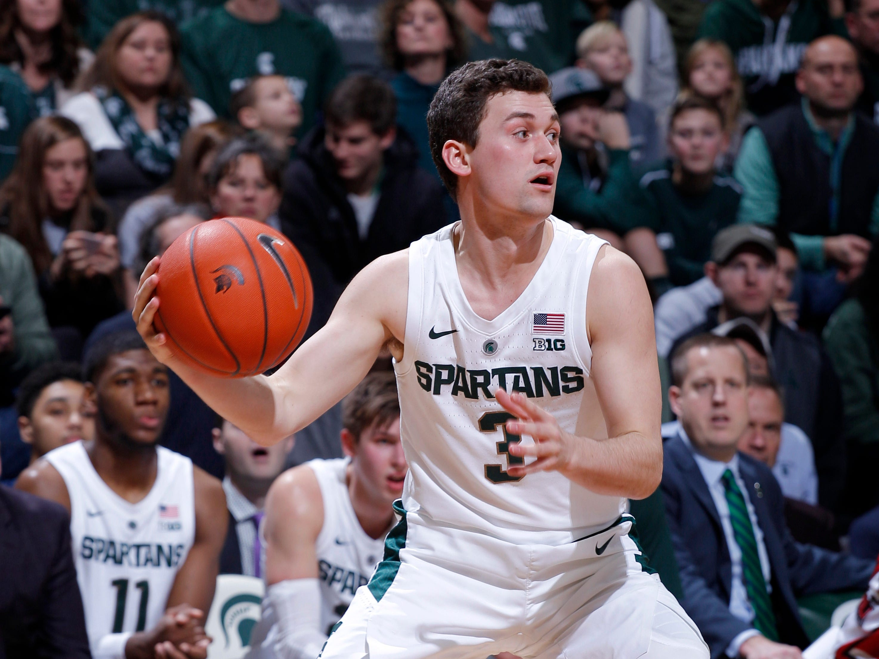 Michigan State's Foster Loyer looks to pass against Northern Illinois' xxx, Saturday, Dec. 29, 2018, in East Lansing, Mich.