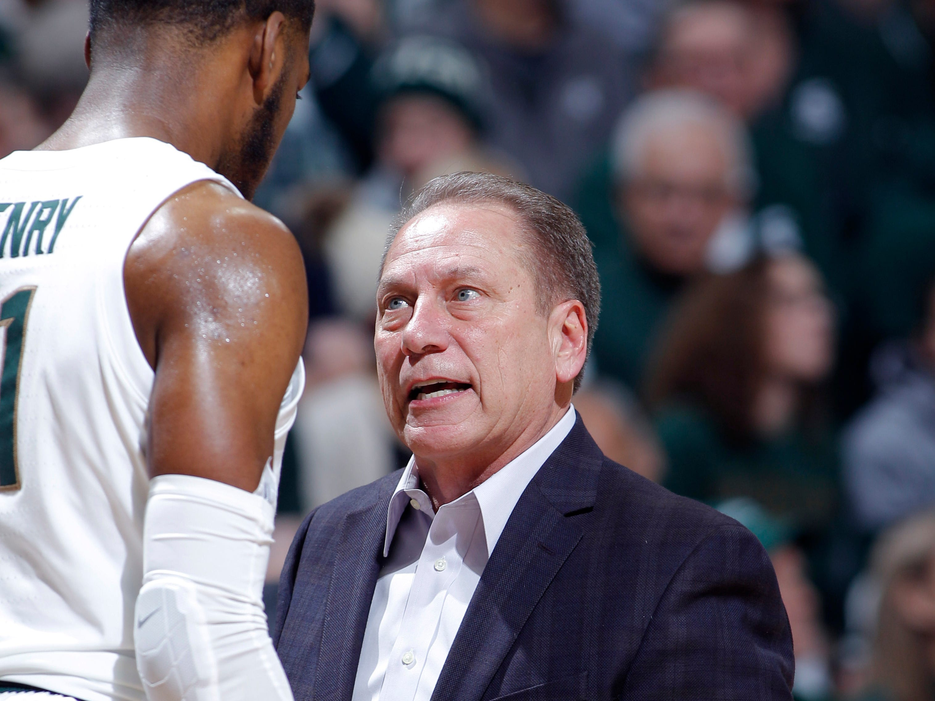 Michigan State coach Tom Izzo talks to Aaron Henry against Northern Illinois, Saturday, Dec. 29, 2018, in East Lansing, Mich.