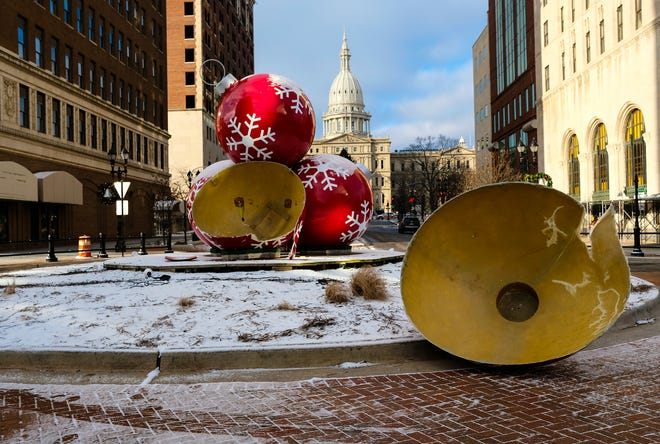The iconic decorations in the roundabout on Michigan and Washington Avenues in Lansing show damage Sunday, Dec. 30, 2018.