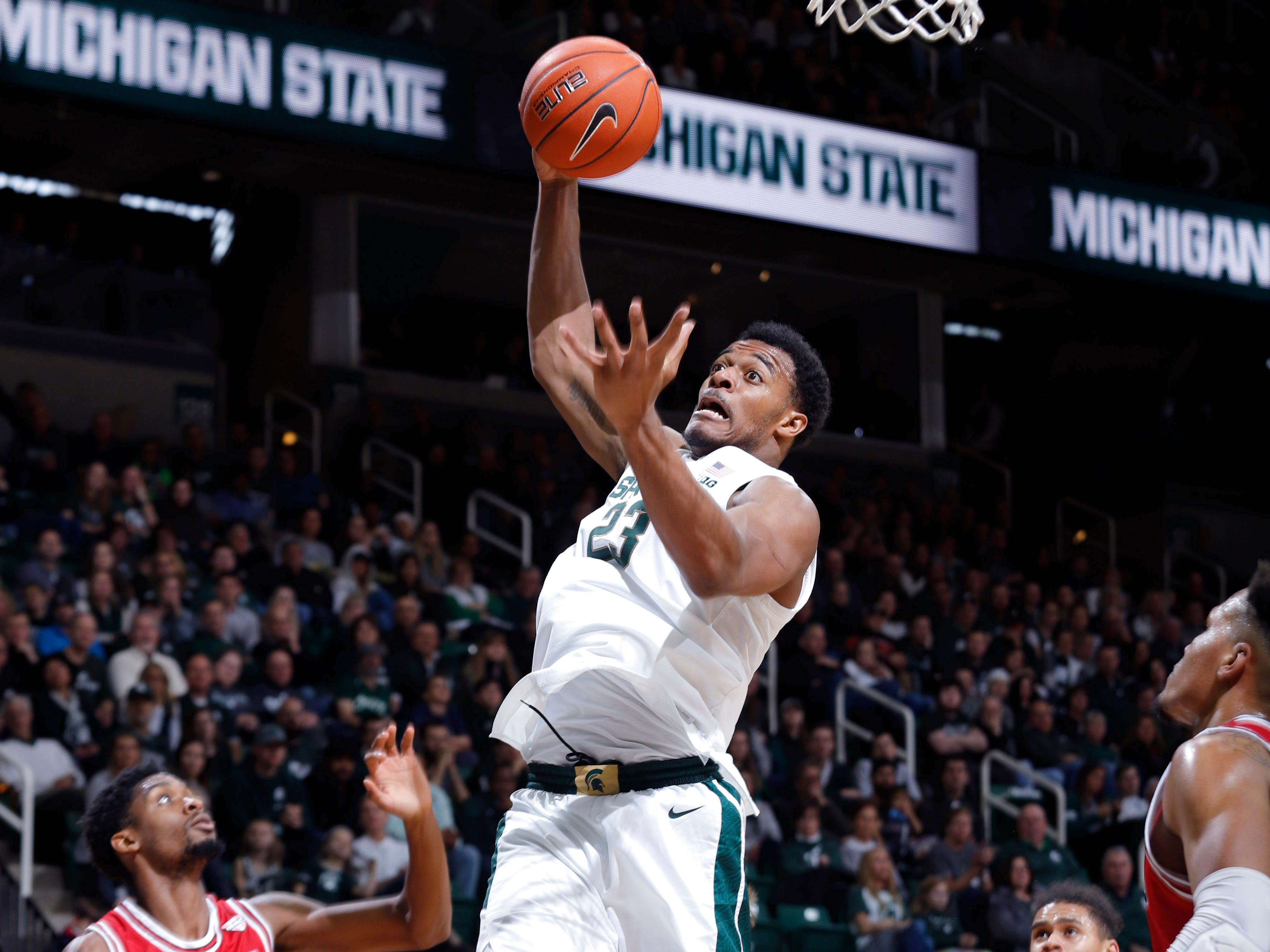 Michigan State's Xavier Tillman rips down a rebound against Northern Illinois, Saturday, Dec. 29, 2018, in East Lansing, Mich.