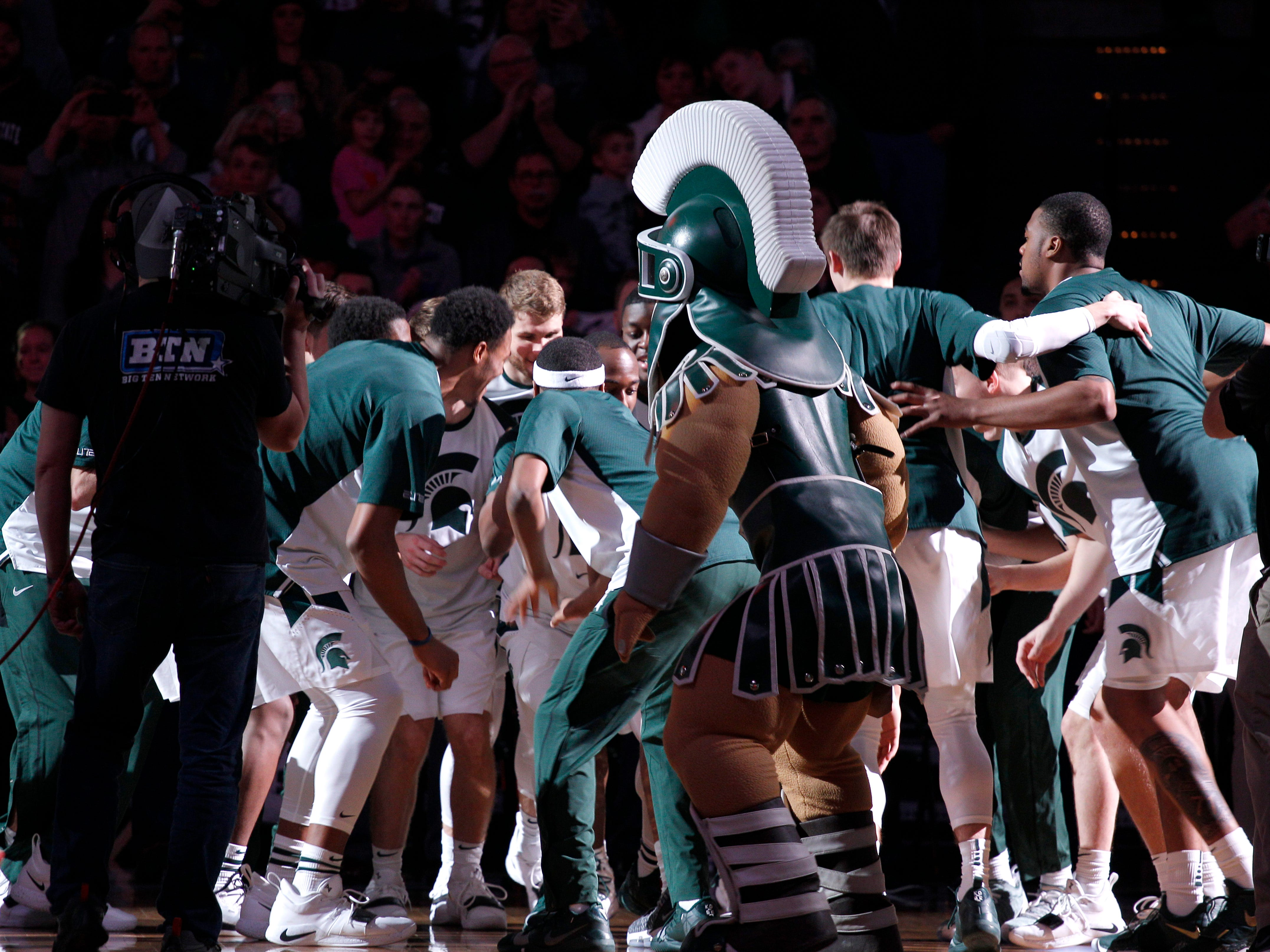 Michigan State players get fired up during introductions before their game against Northern Illinois, Saturday, Dec. 29, 2018, in East Lansing, Mich.
