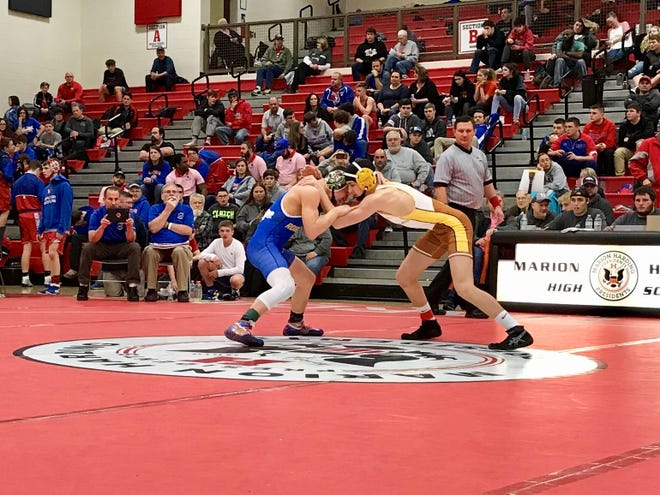 Buckeye Valley's Ethan Szanati, right, ties up Clayton Drummond of St. Marys Memorial at Marion Harding. Officials are hopeful the arrival of the state wrestling tournament this weekend will infuse some tourism dollars into the area.